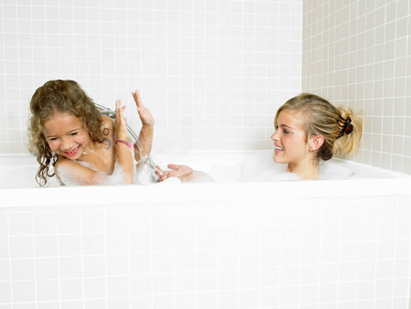 grooming: Sisters playing in a bath, foam