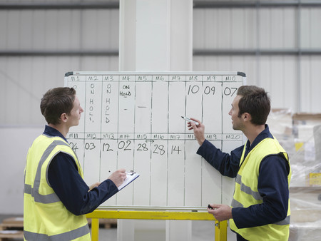 gathers: Workers With Whiteboard In Warehouse LANG_EVOIMAGES