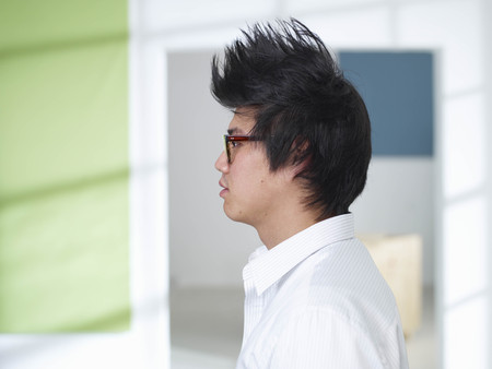 singularity: Young man with mohawk and glasses LANG_EVOIMAGES