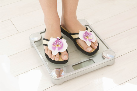 weighs: Feet on scales