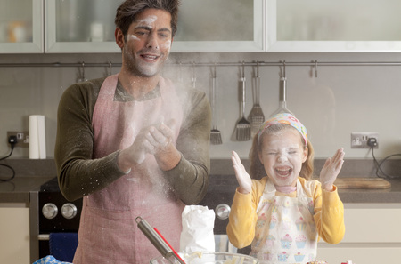 messy clothes: father and daughter cooking