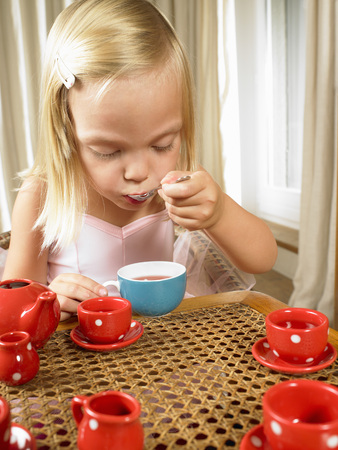 Girl having a tea time