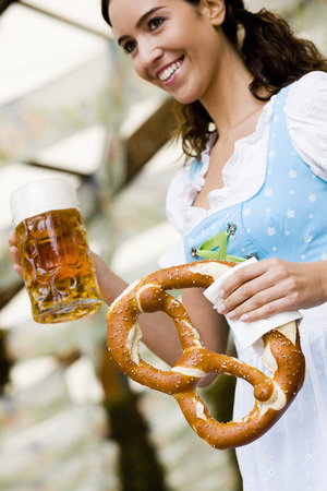 Young Woman with Glass Beer and Pretzel LANG_EVOIMAGES