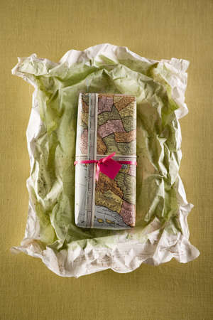 journeying: Gift or present being unwrapped LANG_EVOIMAGES