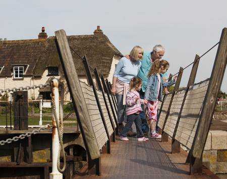 abodes: mature couple with children on walkway