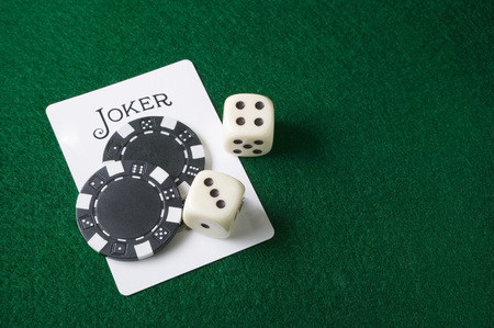 pokers: Joker card and gambling chips and dice