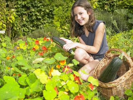 uncomplicated: Girl working in her vegetable garden