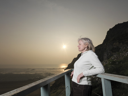 mature woman looking across sea