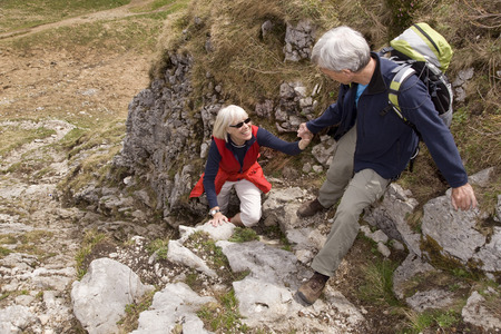 climbed: senior couple hiking in mountains LANG_EVOIMAGES