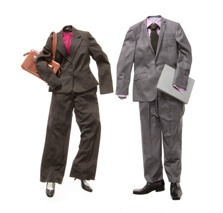 conforms: A male and female business suit LANG_EVOIMAGES