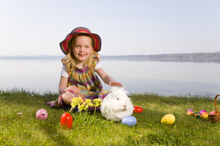 astonishment: girl with bunny and easter eggs
