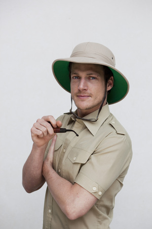 adventuresome: man in jungle outfit looking at viewer