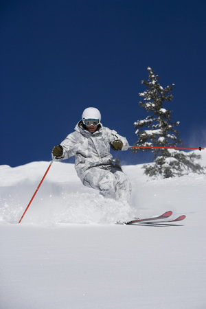 Man in white & grey camo suit off-piste. LANG_EVOIMAGES