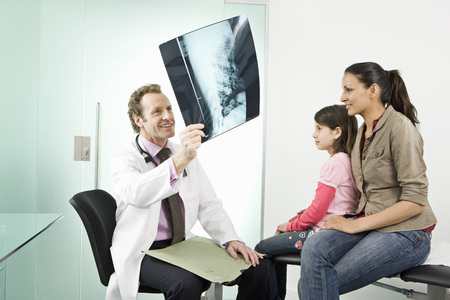 diagnoses: Male doctor checks a patients an x-ray