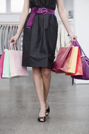 chic woman: woman carrying shopping bags