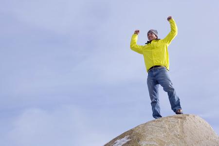 Climber celebrating on mountain peak