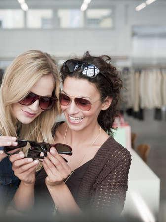 chic woman: women shopping comparing sunglasses