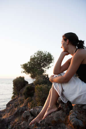 passions: Young Woman Looking At Seaside LANG_EVOIMAGES
