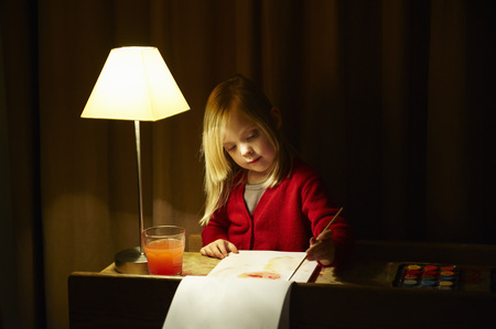down lights: Girl painting at her desk