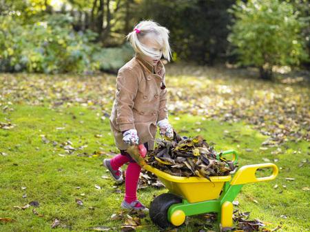 Girl gardening LANG_EVOIMAGES