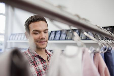 resolving: man shopping looking at shirts