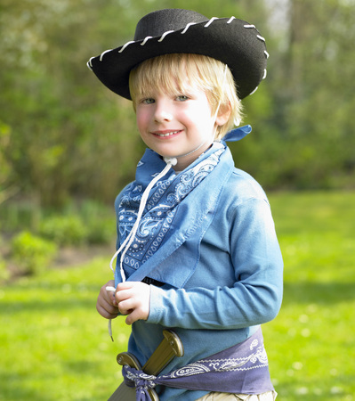 Boy wearing a cowboy costume LANG_EVOIMAGES