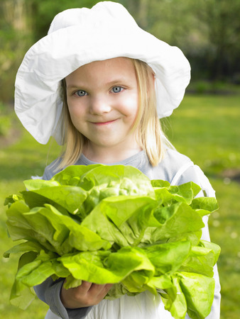 Girl holding a salad from the garden