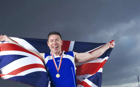 low spirited: athlete cheering with U.K. flag and medal