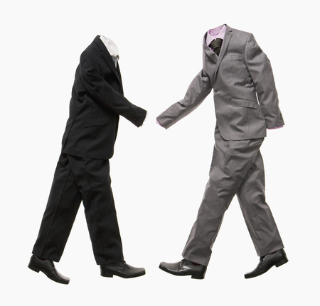 A couple of business suits shaking hands
