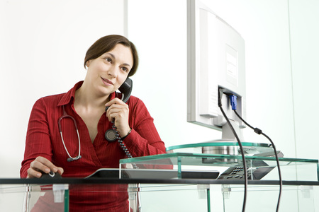 caregivers: A female doctor at her computer