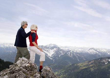 senior couple on mountain summit LANG_EVOIMAGES
