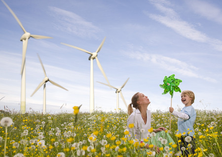 low spirited: mother and son at wind turbine LANG_EVOIMAGES