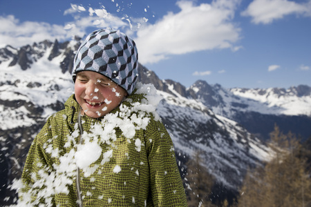 aggressively: Boy hit by snowball.