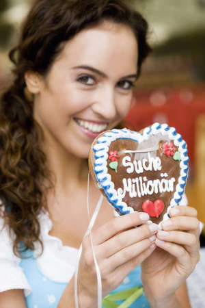 single word: Young Woman With Gingerbread Heart LANG_EVOIMAGES