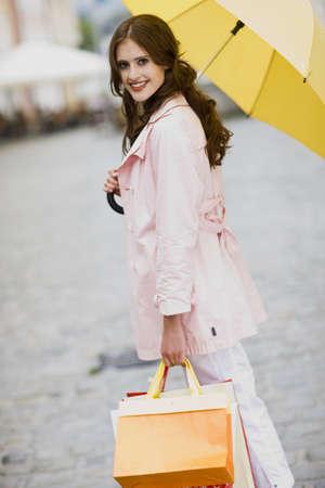 drizzling rain: girl goes shopping in the rain