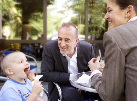 affiliation: business couple with son in outdoor cafe