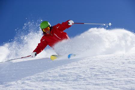 exhilarating: Man in red powder turning.