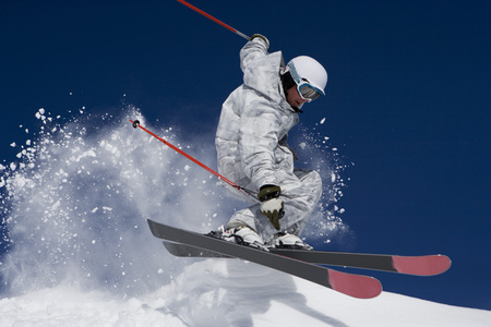 feats: Man in white & grey camo suit off-piste. LANG_EVOIMAGES