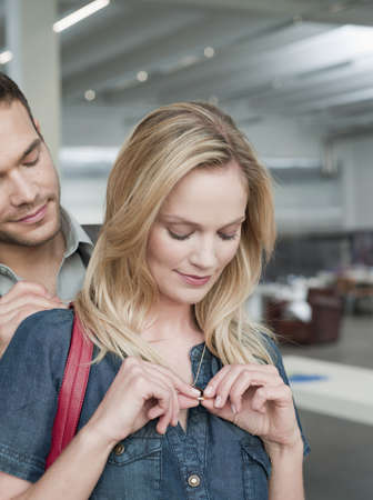 chic woman: couple shopping looking at jewelry