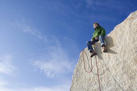 Climber sitting on peak