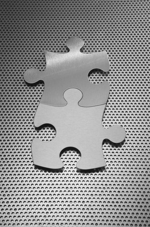 accomplishes: Metal jigsaw puzzle pieces LANG_EVOIMAGES