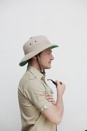 man in jungle outfit holding pipe