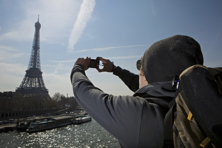blue waters: Man taking photo of eiffel tower LANG_EVOIMAGES