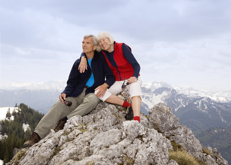 in twos: senior couple on mountain summit LANG_EVOIMAGES