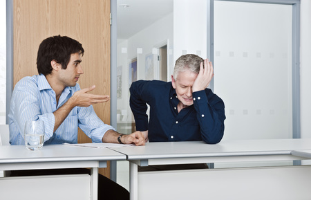motioning: man consoling work colleague