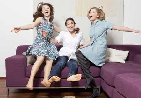 jubilating: Three women jumping and jubilating LANG_EVOIMAGES