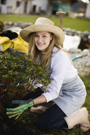 girl in full growth: woman gardening