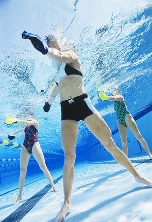 low section: Women exercising in swimming pool. LANG_EVOIMAGES