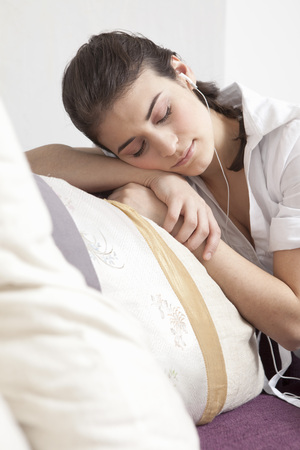 musically: Woman listening to music
