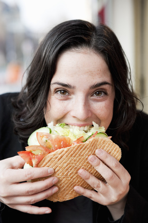 savour: Woman Eating Sandwich